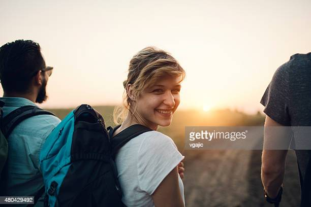 Young Smiling Woman Hiking.