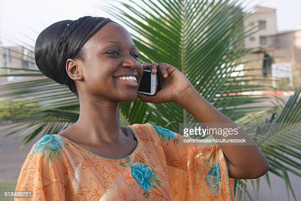 Young smiling woman speaking in mobile phone