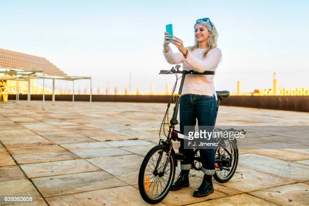 young smiling woman with bicycle