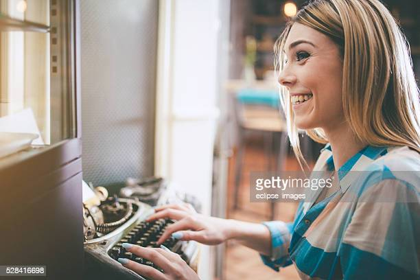 young smiling woman with typewriter