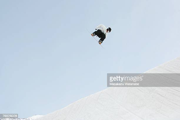 Young snowboarder airborne