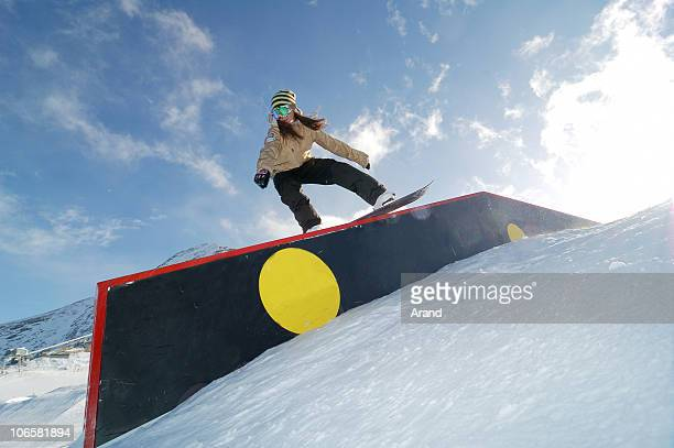 young snowboarder woman jibbing - railings stock pictures, royalty-free photos & images