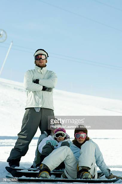 'Young snowboarders on ski slope, full length portrait  '