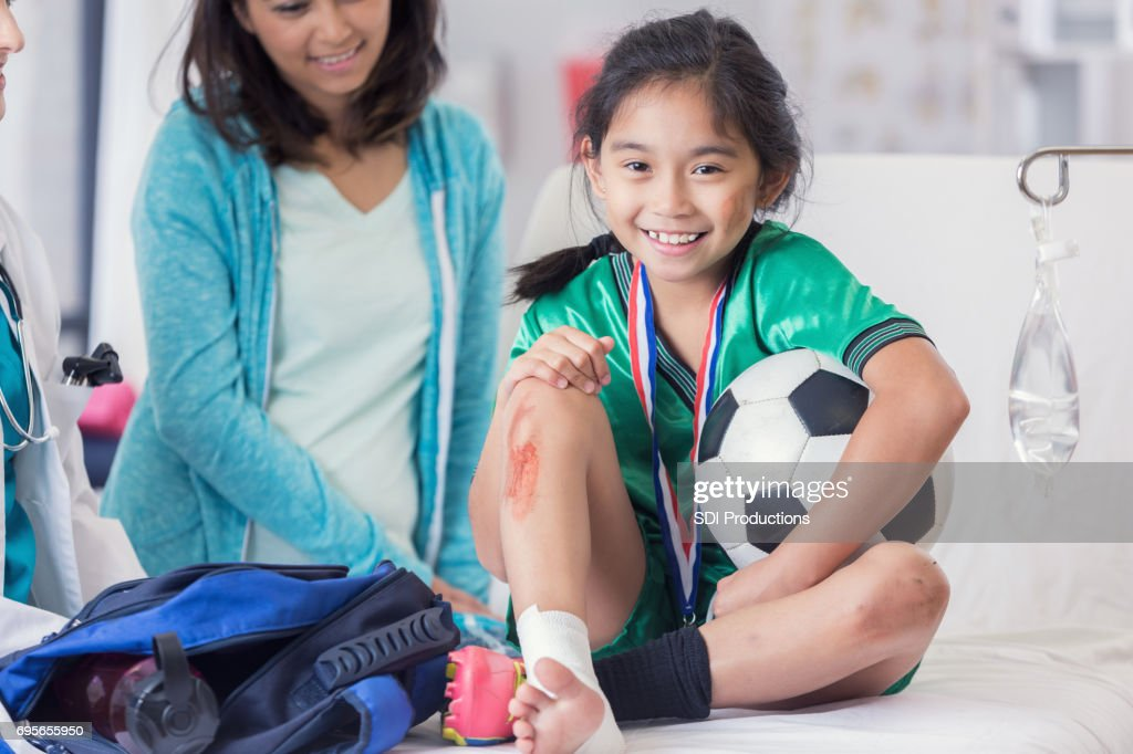 Young soccer champion with injuries : Stock Photo