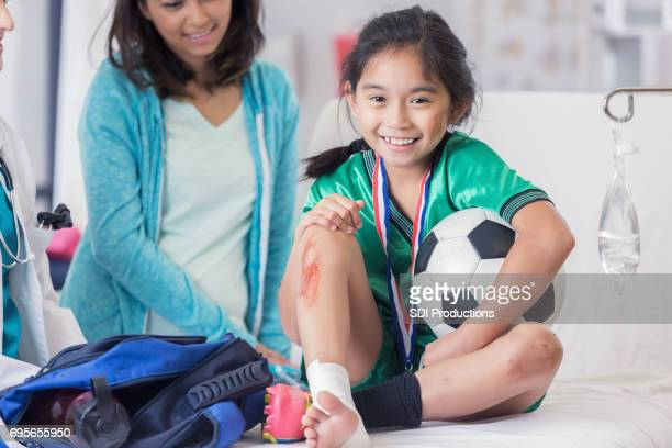 Young soccer champion with injuries