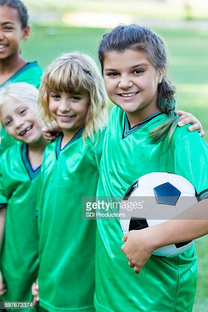 Young soccer friends smile confidently after winning game