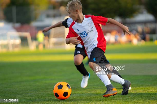 young soccer match duel - junior level stock pictures, royalty-free photos & images