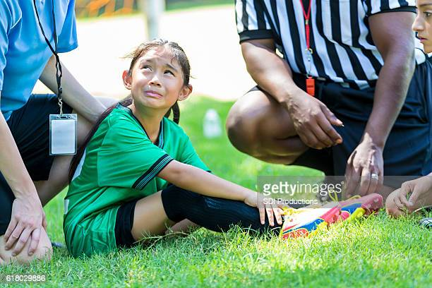 young soccer player cries after injuring ankle - personal injury stock photos and pictures