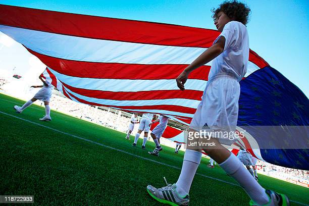 A young soccer player helps carry the USA flag onto the field during the match between the Columbus Crew and the Vancouver Whitecaps FC July 6 2011...