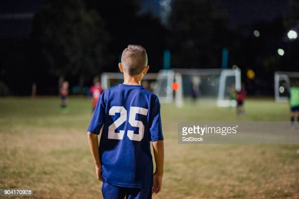 young soccer player - football strip stock pictures, royalty-free photos & images