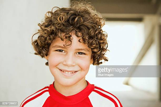Young soccer player smiling