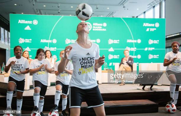 Young soccer players perform during the Frauen Bundesliga season opening news conference at Fussball Museum on September 10 2018 in Dortmund Germany