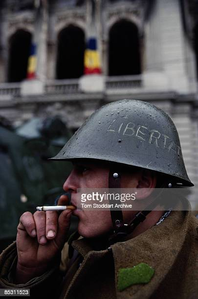 A young soldier in Palace Square later renamed Revolution Square in Bucharest during the Romanian Revolution December 1989 The word 'Libertate' or...