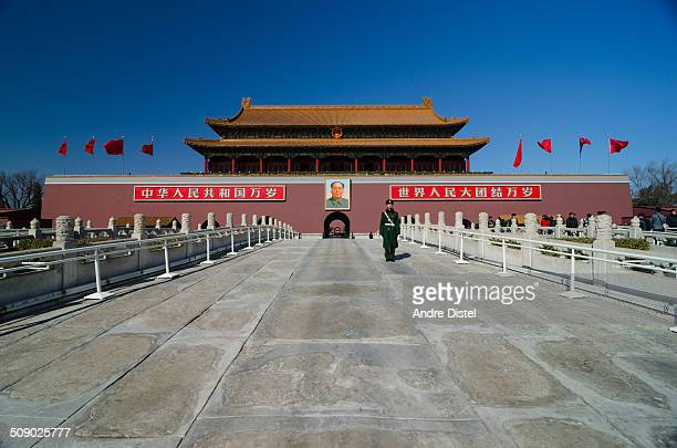A young soldier is standing in front of the Tiananmen Square Forbidden City protecting the main entrance as tourist can walk in through the side The...