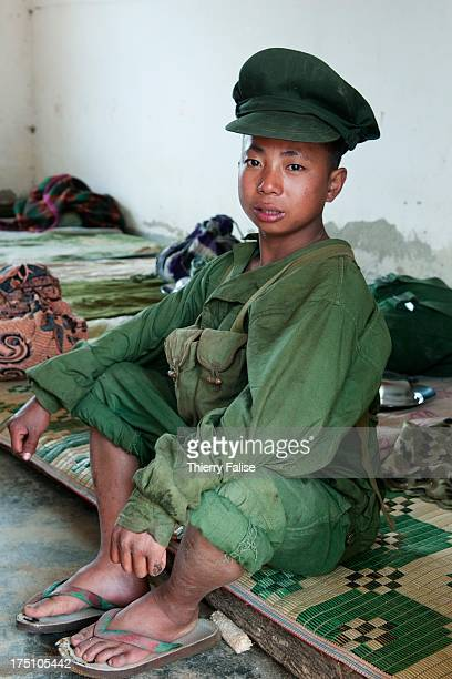 A young soldier of the Kachin Independence Army sits in his dormitory With its 6000 troops the KIA is one of the best organized and equipped armed...