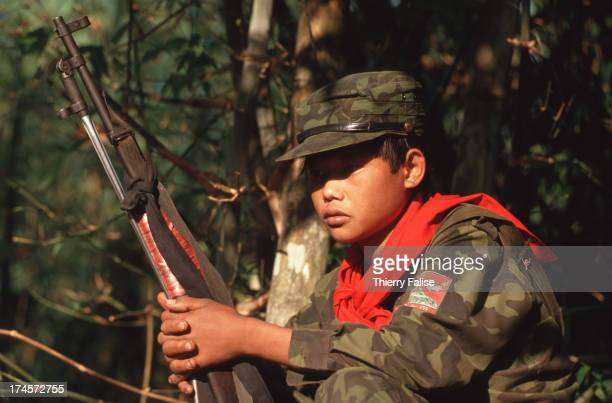 Young soldier of the United Wa State Army during an expedition from Thailand's border to northern Wa State in Burma along the Chinese border..