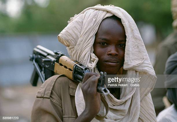 A young soldier with the Forces Armees Nationales Chadiennes or National Army of Chad guards the streets of N'Djamena with a machine gun Lead by...