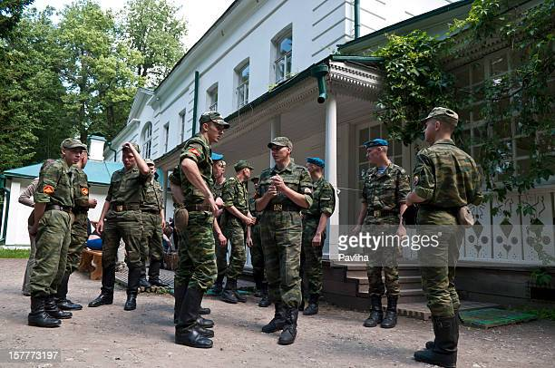 young soldiers visiting tolstoy's home - pavliha stock photos and pictures