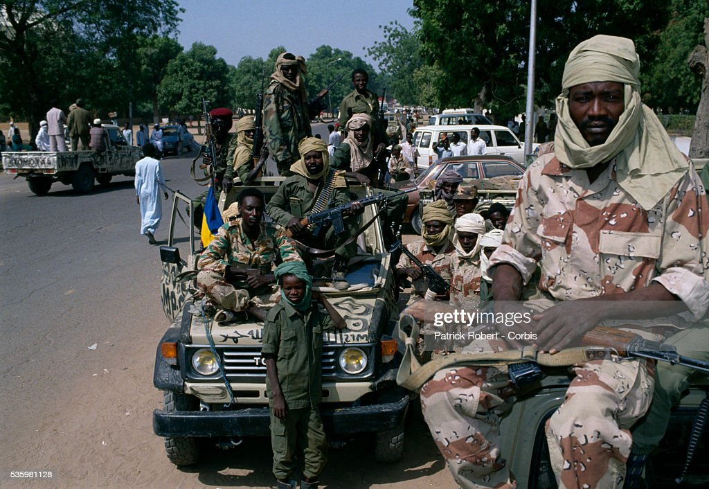 Young soldiers with the Forces Armees Nationales Chadiennes (FANT), or National Army of Chad, guard the streets of N'Djamena with machine guns. Lead by Chadian Chief of Staff Idriss Deby, the FANT rebellion seized power from head of state Hissen Habre in a French and Libyan-backed military coup. Deby later won the first multi-party Chadian presidential vote in 1996.