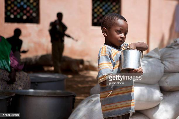 A young Somali boy gather free food at a feeding kitchen operated by the Non Government Organization SAACID SAACID has been running a food kitchen...