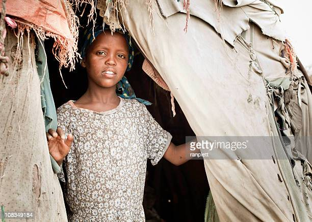 young somali girl in a nomadic hut - armoede stockfoto's en -beelden