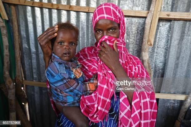 MOGADISHU SOMALIA MARCH A young Somali mother and child wait to register for humanitarian aid at World Food Program center in central Mogadishu...