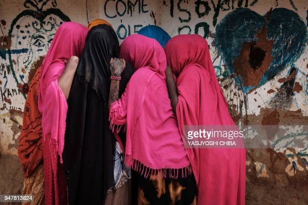 TOPSHOT Young Somali refugee women stand together at Dadaab refugee complex in the northeast of Kenya on April 16 2018 The Dadaab refugee complex...