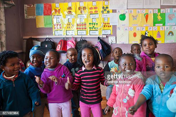 Young South African children sing and dance in an Early Childhood Development centre in Philippi township Cape Town South Africa The centre is part...