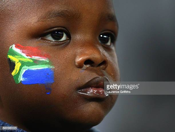 Young South African fan enjoys the atmosphere during the FIFA Confederations Cup match between Spain and South Africa at Free State Stadium on June...