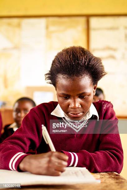 Young South African girl concentrating in a rural classroom