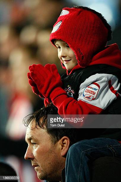 A young Southampton fan applauds during the FA Cup 3rd round match between Coventry City and Southampton at the Ricoh Arena on January 07 2012 in...