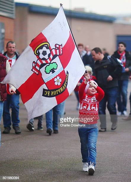 A young Southampton fan waves a flag outside the stadium prior to the Barclays Premier League match between Southampton and Tottenham Hotspur at St...