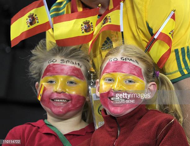 Young Spain football fans await the start of the 2010 World Cup semifinal football match between Germany and Spain on July 7 2010 at Moses Mabhida...