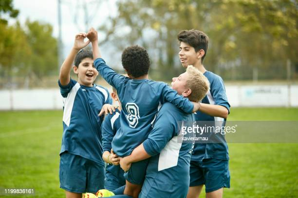 young spanish male footballers celebrating triumph - sporting term stock pictures, royalty-free photos & images