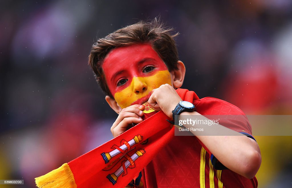 A young Spanish supporter kisses his country's badge prior to the UEFA EURO 2016 Group D match between Spain and Czech Republic at Stadium Municipal on June 13, 2016 in Toulouse, France.
