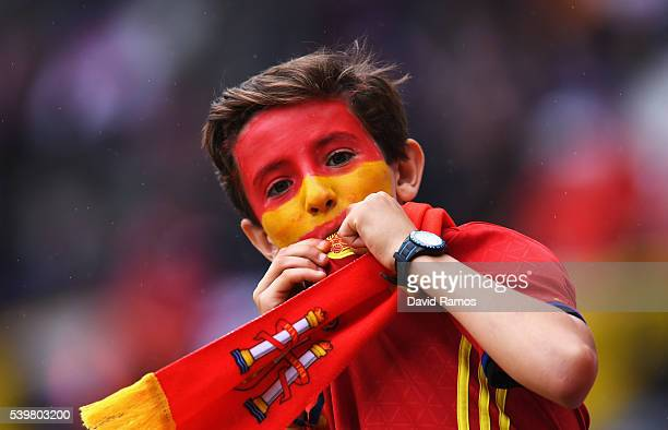 A young Spanish supporter kisses his country's badge prior to the UEFA EURO 2016 Group D match between Spain and Czech Republic at Stadium Municipal...