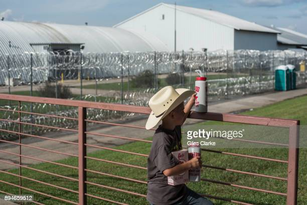 ST FRANCISVILLE LOUISIANA OCTOBER A young spectator at the Louisiana State Penitentiary Rodeo Stadium The idea of the rodeo was born in 1964 The...