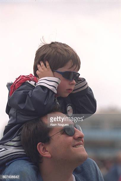 Young spectator deafened by the jet engines.