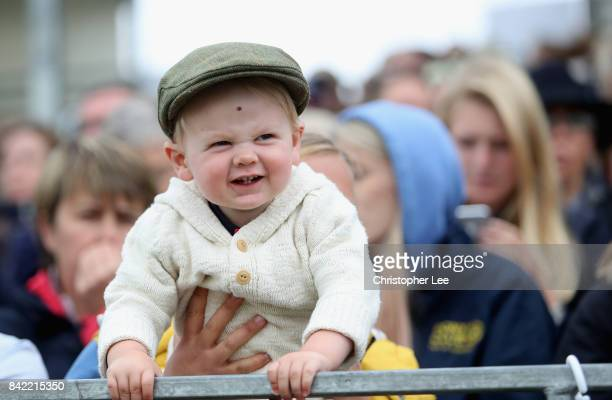 A young spectator enjoys the show jumping during Day Four of The Land Rover Burghley Horse Trials 2017 on September 2 2017 in Stamford England