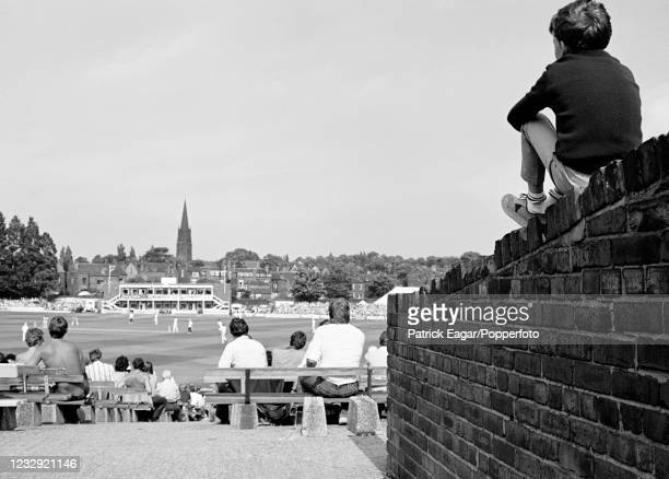 Young spectator finds an elevated vantage point during the 2nd Test match between England and New Zealand at Headingley, Leeds, 28th July 1983. New...