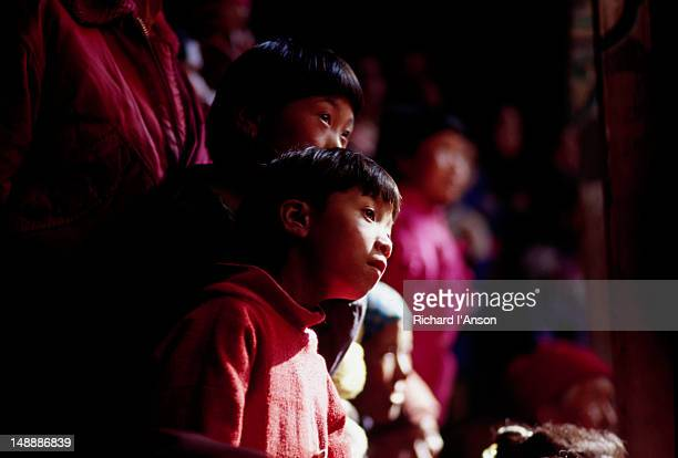 young spectators at the mani rimdu festival at chiwang gompa (monastery). - mani rimdu festival stock pictures, royalty-free photos & images