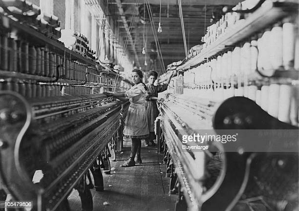 A young spinner in Bibb Mill Number 1 stands in the middle of the spinning room enduring bad lighting and ventilation Macon GA January 1909 A spinner...