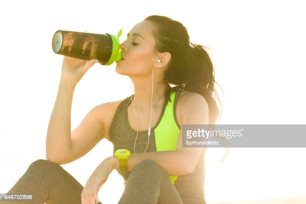 Young sport woman drinking