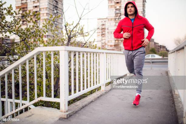 Young sportsman running in an urban environment.