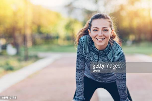 young sportswoman exercising in the park - sportsperson stock pictures, royalty-free photos & images