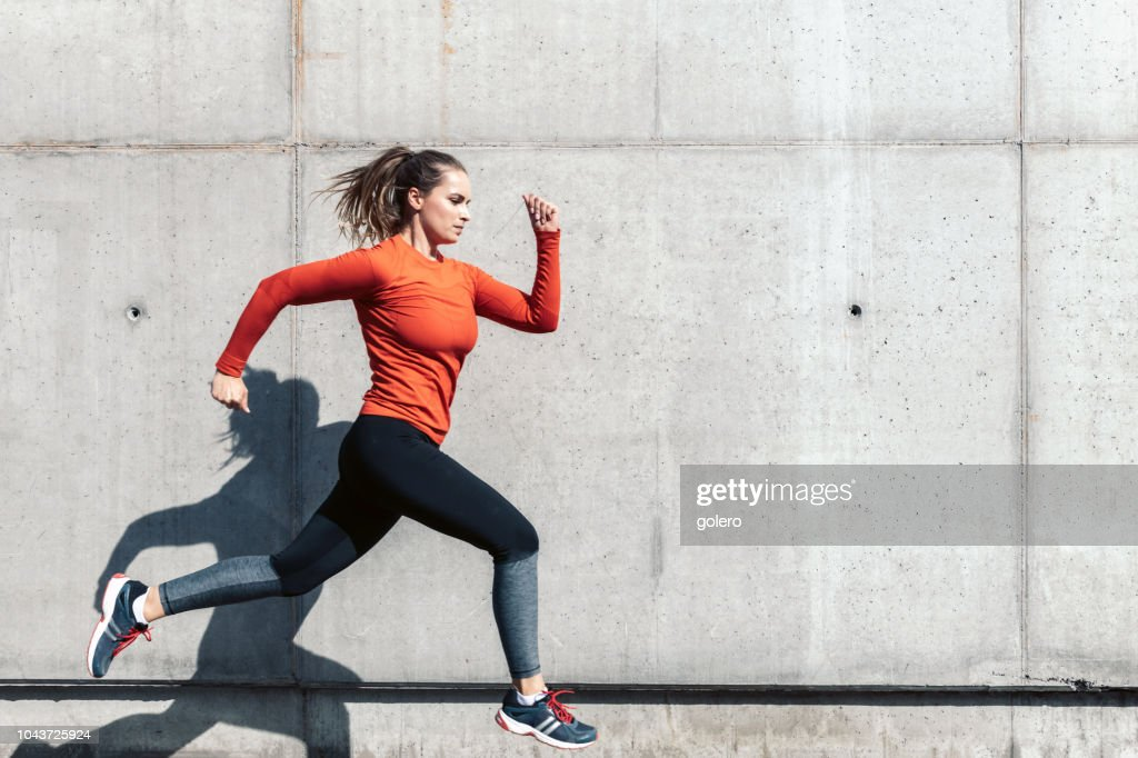 young sportswoman running outdoors : Stock Photo