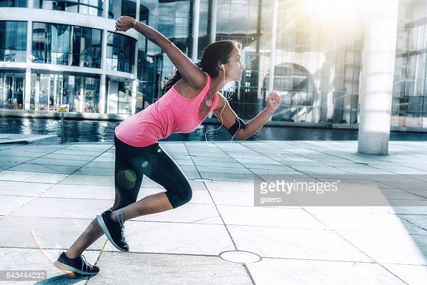 young sportswoman starting for sprint outdoors