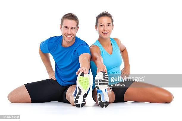 Junges sportliches paar Dehnung zusammen