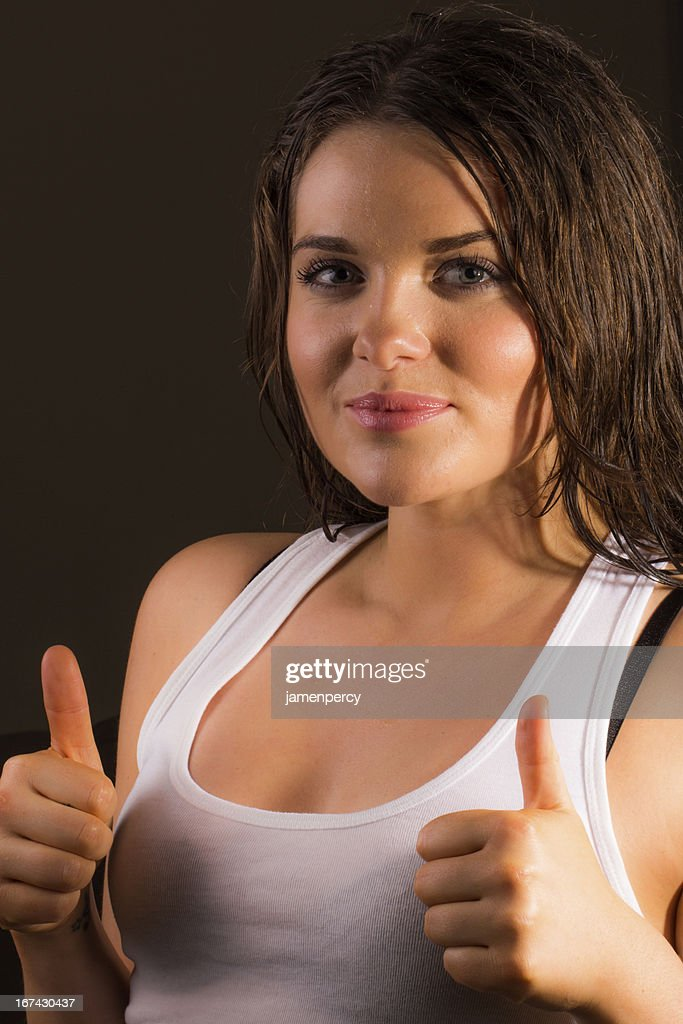 Young sporty female giving the thumbs up : Stock Photo