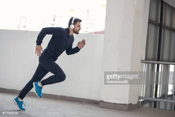 Young sporty man having training session